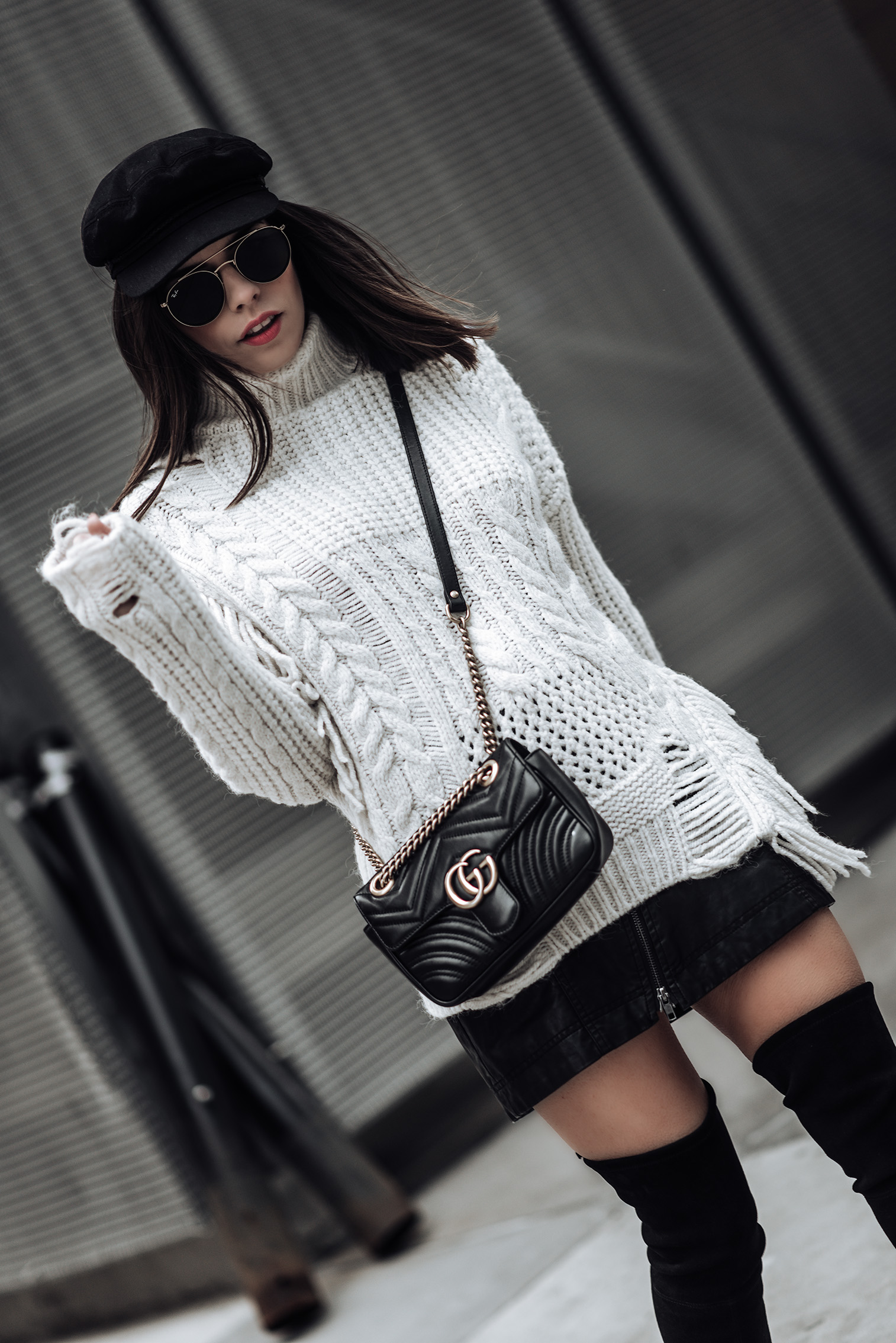 Texture | Chunky Cable Knit Sweater | Free People Vegan Mini skirt | Gucci Marmont Bag | Stuart Weitzman Funland Boots |