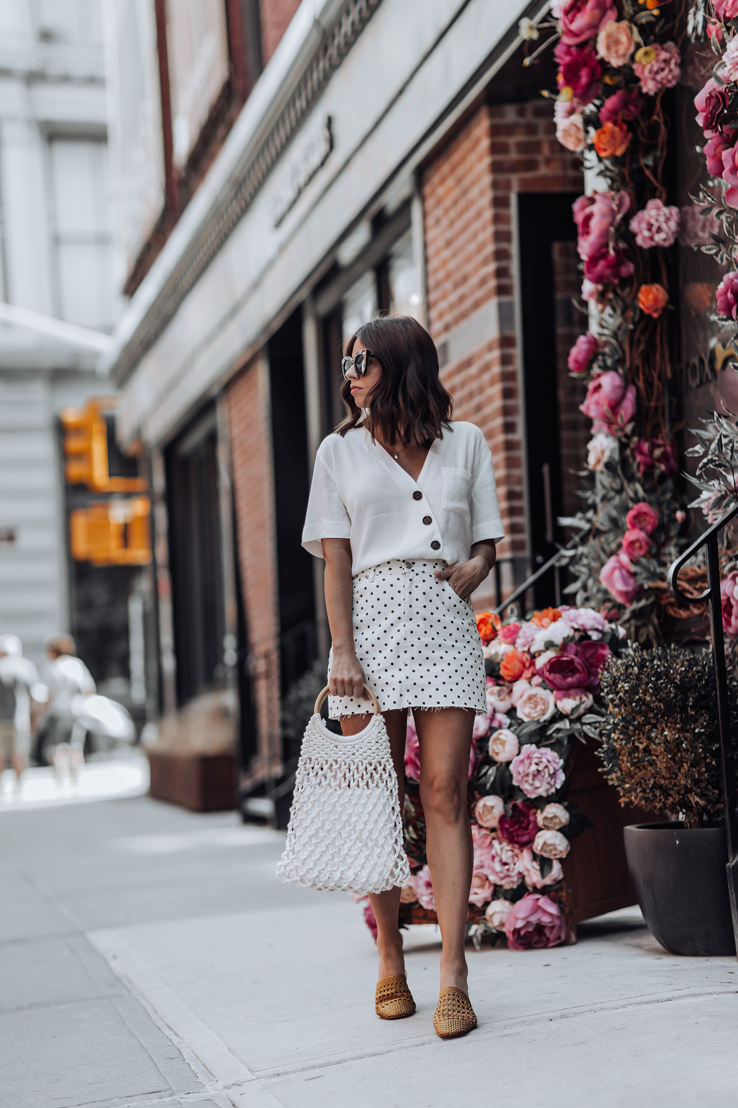 All white |Topshop Polka Dot Skirt | Topshop Blouse | String Shopper Bag | Woven Mules| Straw handbag Trend | Streetstyle blog #streetstyle #ootd #liketkit #topshop