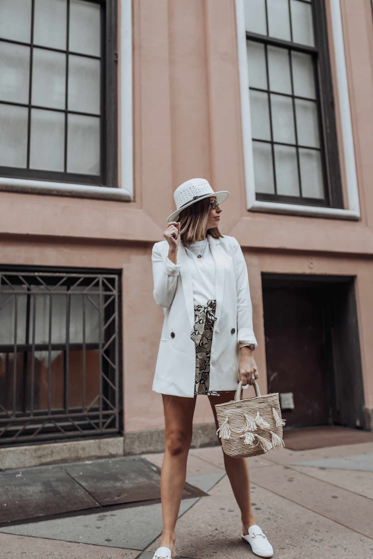 Mixing spring and fall pieces   White mules   Skirt (Zara, similar here)   Similar Hat   White Blazer  Tassel Bag #snakeprint #blazeroutfits #topshop #zara #streetstyle