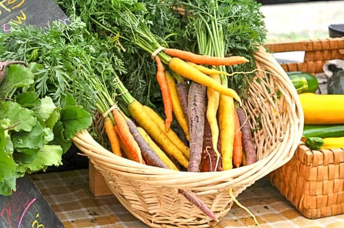 Rainbow carrots in a wicker basket to make Roasted Carrots with Honey-Mustard Glaze