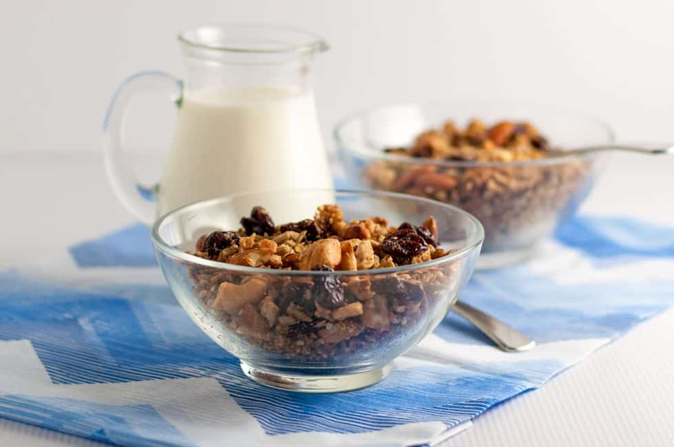 Two bowls of Cherry Vanilla Grain-Free Granola with a pitcher of milk in the background.