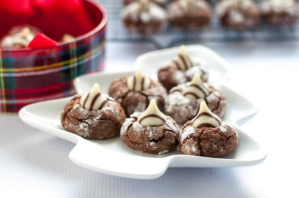 These Zebra Cookies are soft chocolate thumbprint cookies with a Hershey's Hug in the centre. They look stunning on a cookie tray!