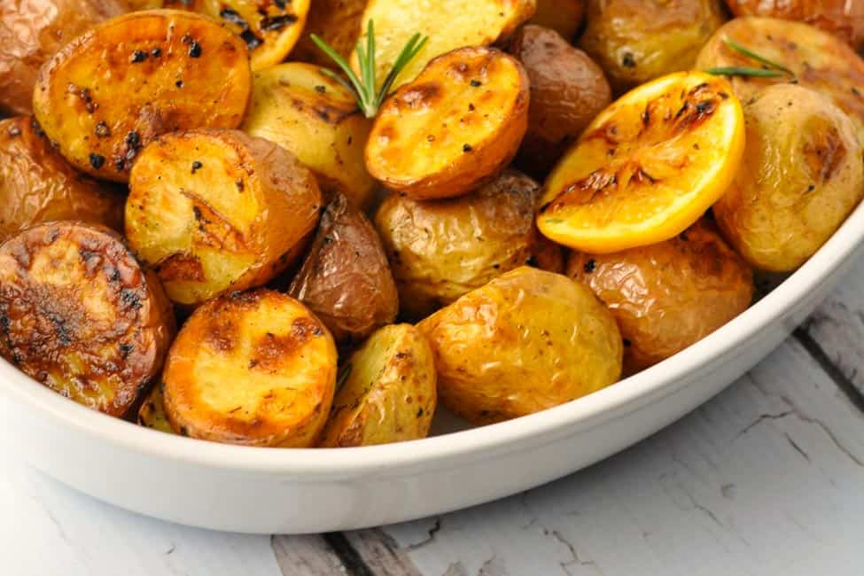 Crispy Lemon Oven-Roasted Potatoes. Crispy on the outside, soft and tender inside! The easiest gourmet potatoes you'll ever make. |www.flavourandsavour.com