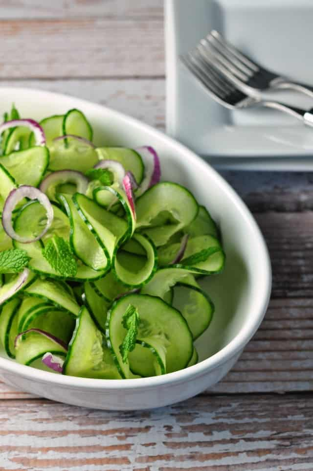 Cucumber Mint Salad with Red Onion and Thai Dressing. Sweet red onions and a flavourful Thai dressing turn plain cucumbers into something fancy. This Cucumber Mint Salad is ready in less than 10 minutes! An easy spring salad. |www.flavourandsavour.com