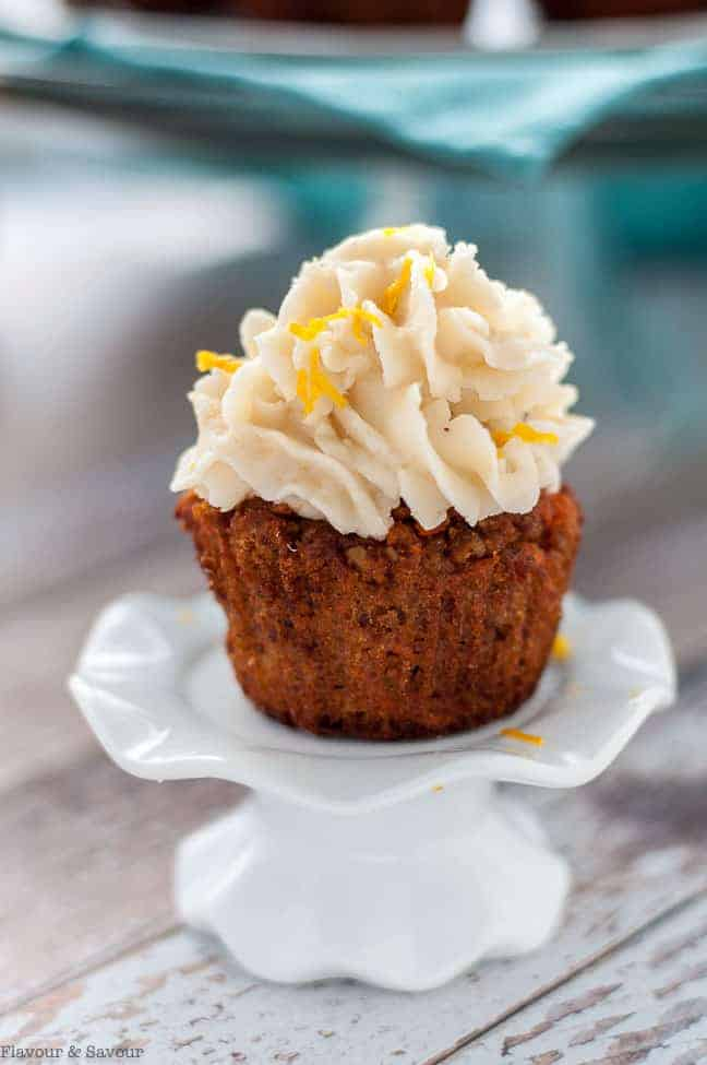 Paleo Carrot Cake Cupcakes with Coconut Butter Frosting. A single cupcake on a cupcake pedestal stand.