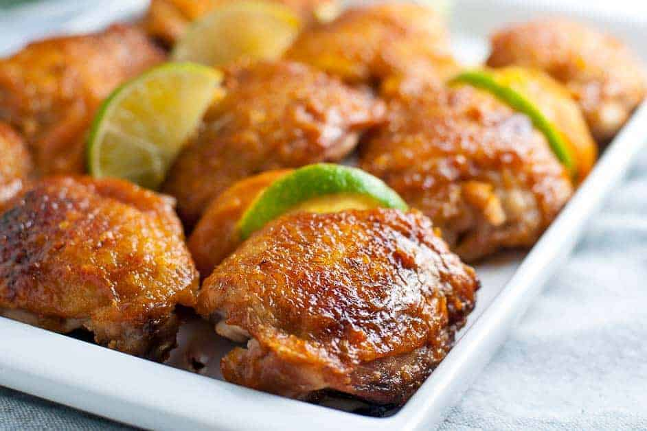 Chipotle Peach Glazed Chicken Thighs on a serving platter. Close up view.