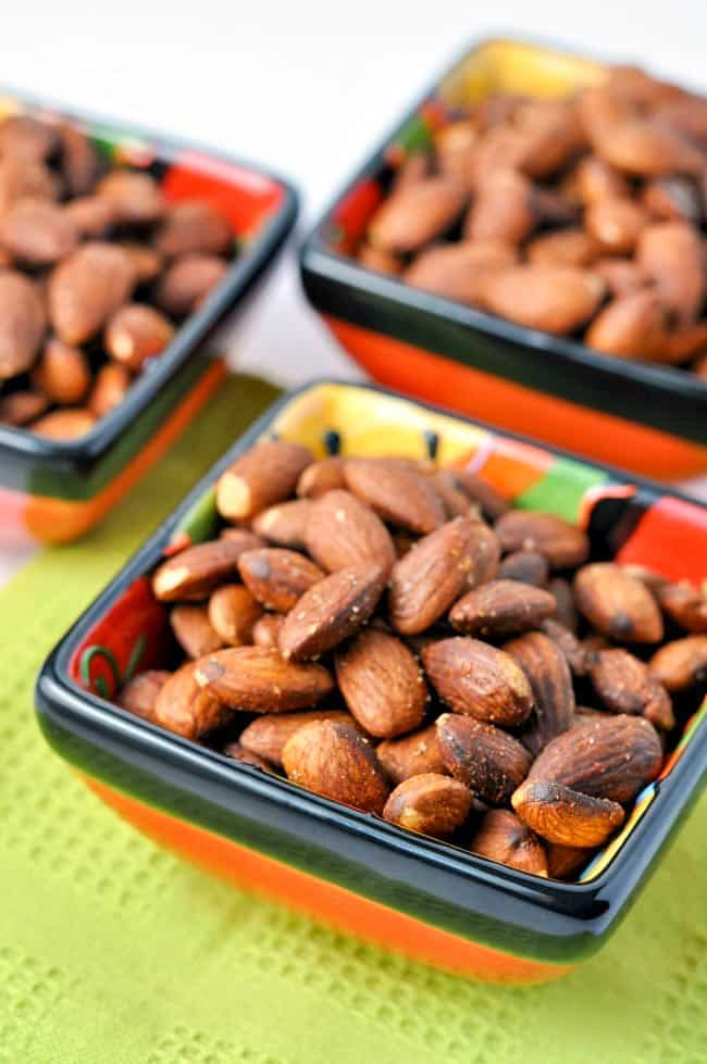 Spanish Spiced Almonds in 3 small square bowls.