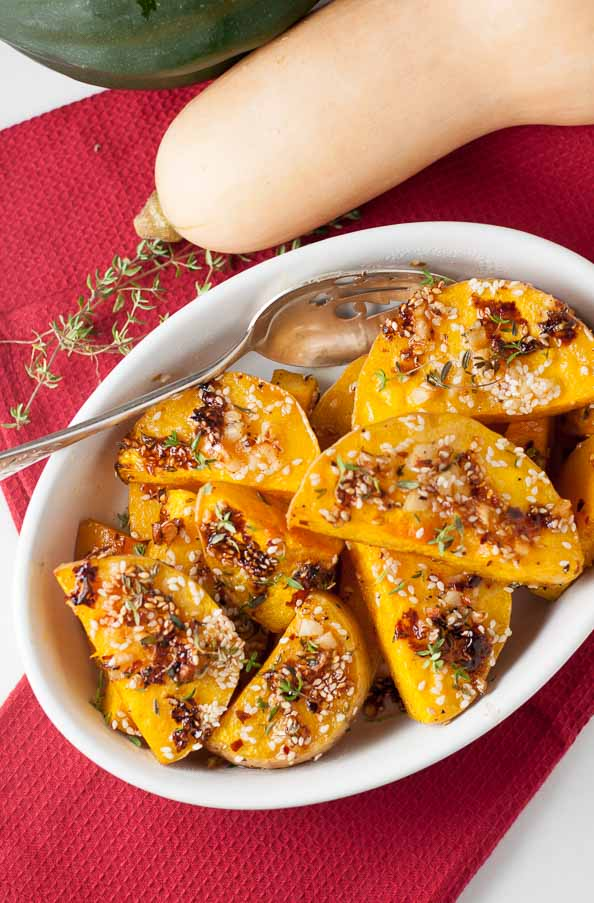Chili Garlic Glazed Butternut Squash. Tender roasted squash with a crisp spicy glaze. One to add to your list of holiday side dishes.
