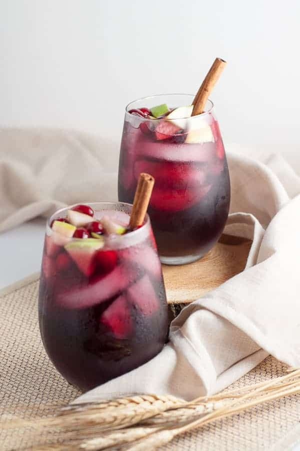 Two glasses of Cranberry Apple Cider Sangria |www.flavourandsavour.com