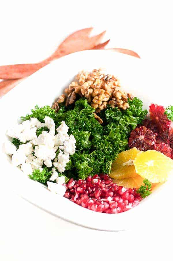 Fit and Healthy Kale Salad with Superfoods. Beat the winter blahs by filling up with healthy superfoods like kale, pomegranate, oranges and walnuts! |www.flavourandsavour.com