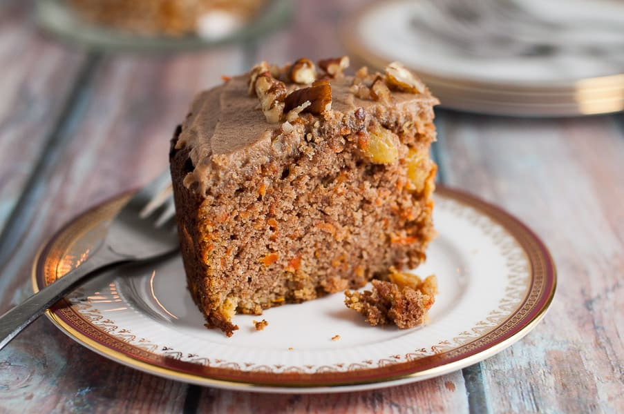 Paleo Carrot Cake with Maple Pecan Glaze on a plate.