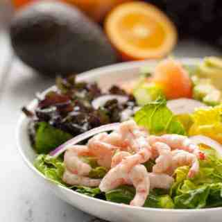 Citrus Avocado Salad with Baby Shrimp and Smoky Vinaigrette. A healthy salad full of kale, romaine, citrus fruits, avocado and optional shrimp, all tossed with a smoky vinaigrette.