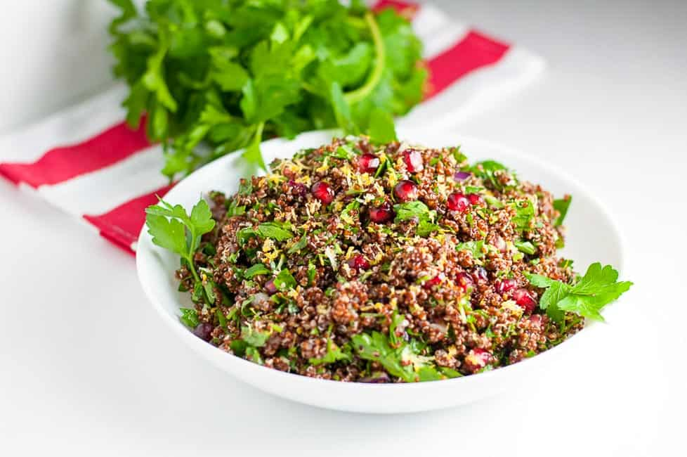 This Red Quinoa Tabouli with Pomegranate is a healthy gluten-free salad for a fall or winter meal. Pomegranate arils give it a festive touch. It has all the flavour of tabouli without the gluten! |www.flavourandsavour.com