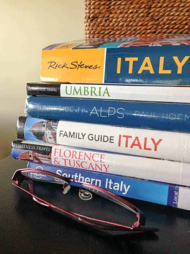 Stack of travel books for Italy