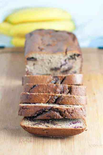 Chocolate Swirl Banana Bread with Raspberries. Grain-free, naturally sweetened banana bread. Rises beautifully,holds it shape, is moist, chocolatey and delicious!