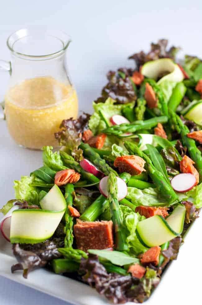 Asparagus Salad with Smoked Salmon and Sesame Miso Vinaigrette. A Paleo and gluten-free fresh asparagus salad with smoked salmon, zucchini ribbons, and radishes on crisp greens with a to-die-for sesame miso dressing. A beautiful spring salad