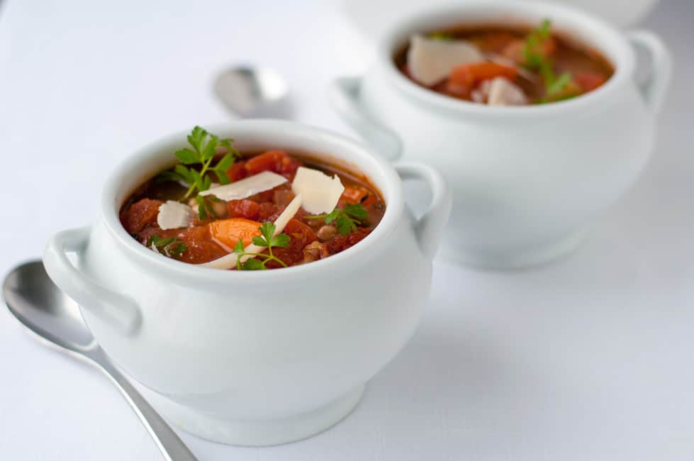 One-Pot Healthy and Hearty Tuscan Minestrone Soup in white soup tureens.