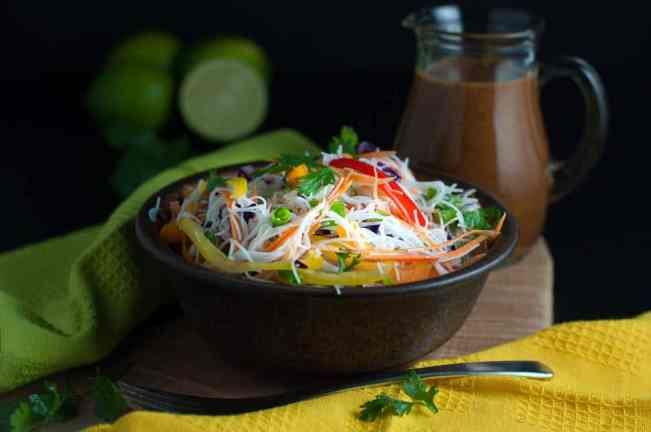 Crisp peppers, cabbage, carrots and cucumber, and crunchy peanuts are all tossed together with rice vermicelli and a spicy Thai-style peanut sauce in this Super Crunchy Thai Noodle Salad. |www.flavourandsavour.com