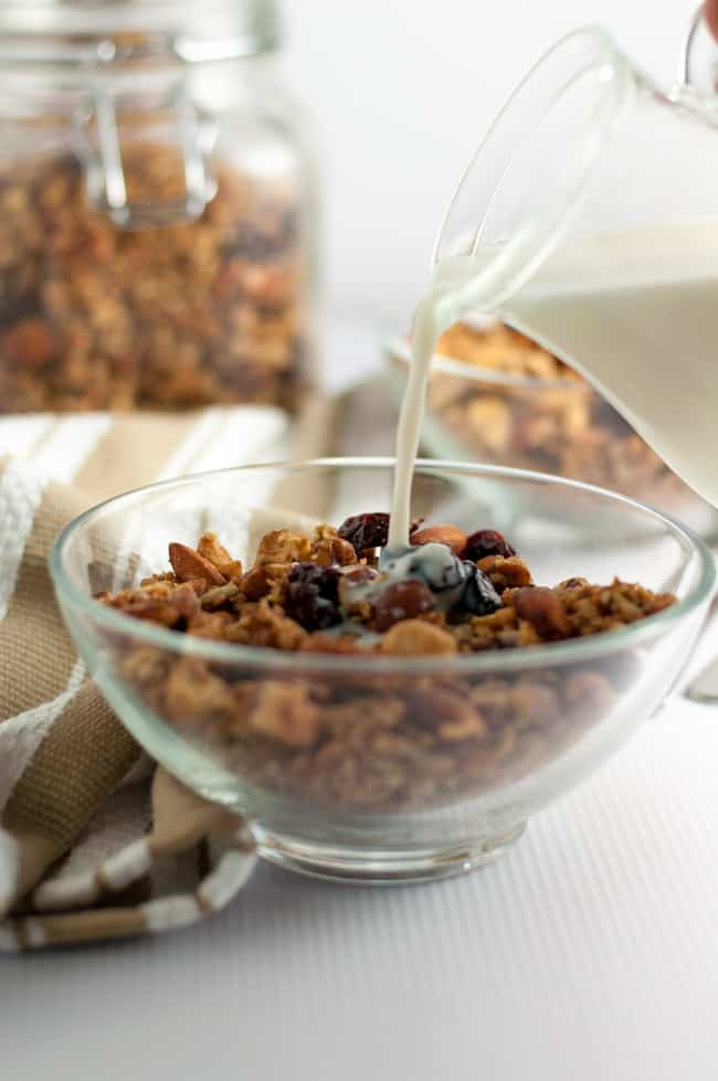 Pouring milk on a bowl of Cherry Vanilla Grain-Free Granola.