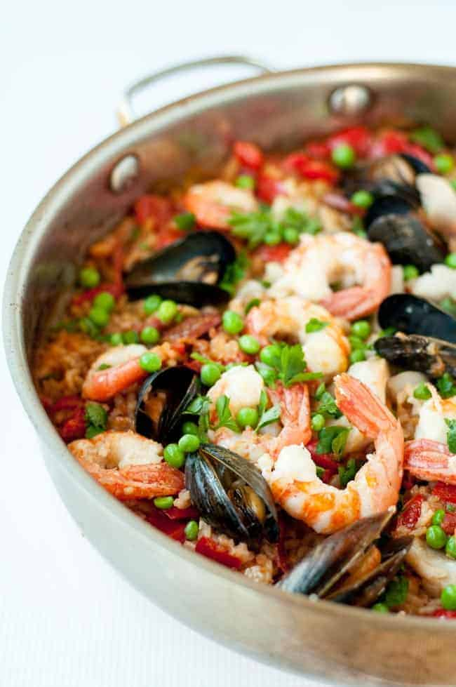 Hosting a Paella Party. How to make authentic paella in a skillet. Hosting a Paella Party in your kitchen. Tips for making paella, a traditional Spanish rice and seafood dish. Step-by-step instructions for a successful paella party!|www.flavourandsavour.com