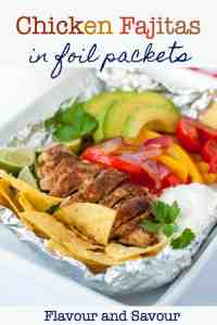 Easy Chicken Fajitas in Foil Packets with coloured peppers, avocado and tomatoes.