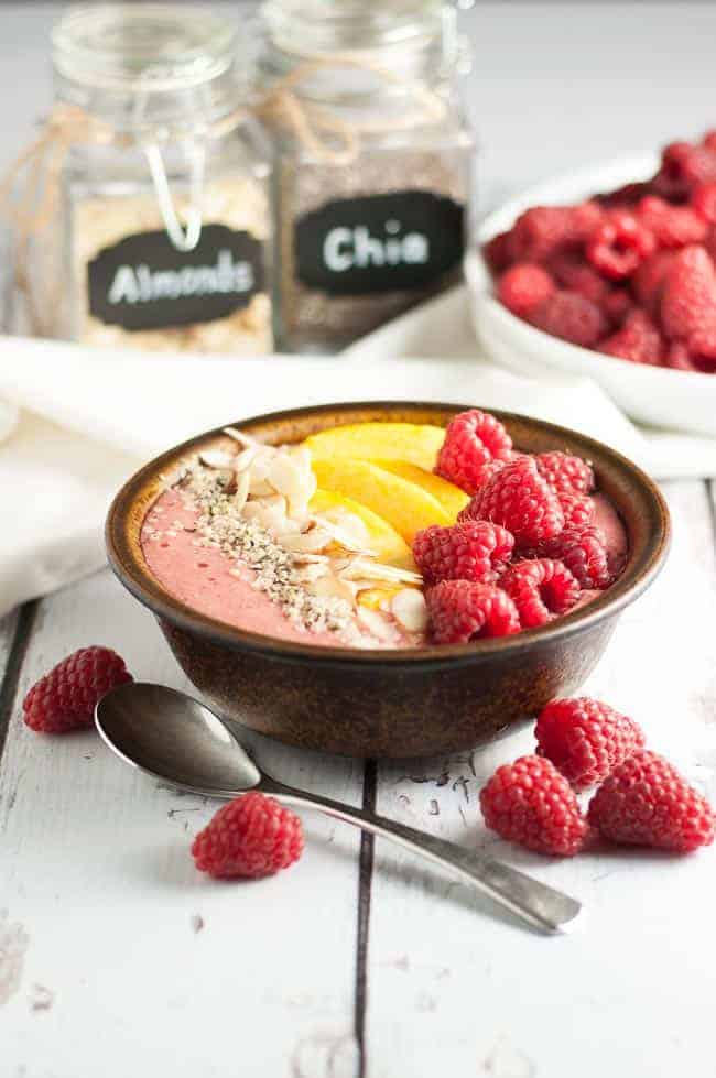 Healthy Peach Melba Breakfast Smoothie Bowl. Paleo! Eat clean with all the benefits of a smoothie, but with the added benefits of fun, nutritious toppings! |www.flavourandsavour.com
