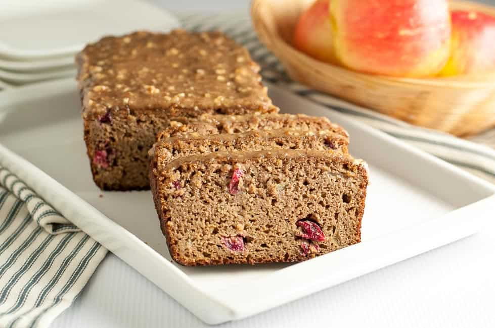 This tender Grain-Free Apple Cranberry Bread is tender is topped with a naturally sweet glaze made from pecans, maple syrup and coconut oil. A healthy paleo snack!  www.flavourandsavour.com