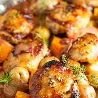 This Sheet Pan Chicken and Roasted Harvest Vegetables is flavoured with bacon and rosemary. Crispy chicken and roasted vegetables make a complete meal, made in one pan, baked in just 30 minutes.  www.flavourandsavour.com