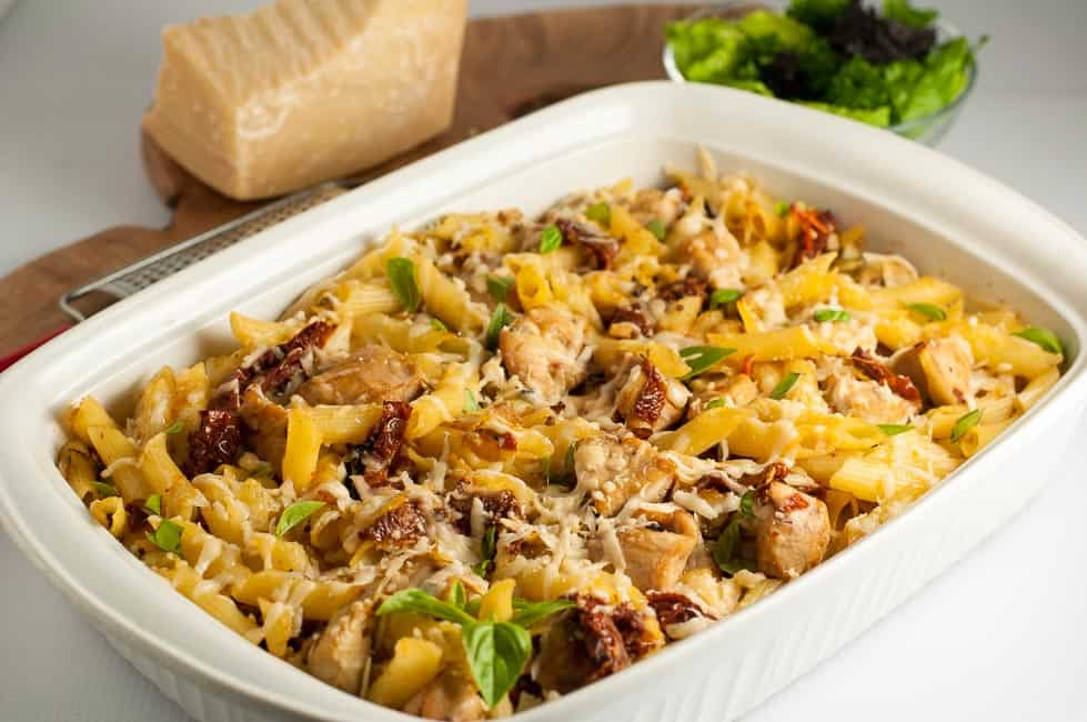 This Sun-dried Tomato Artichoke Penne Pasta has robust Italian flavours of tomatoes, artichokes, garlic and Parmesan cheese, all in one gluten-free pasta and chicken dish!  www.flavourandsavour.com