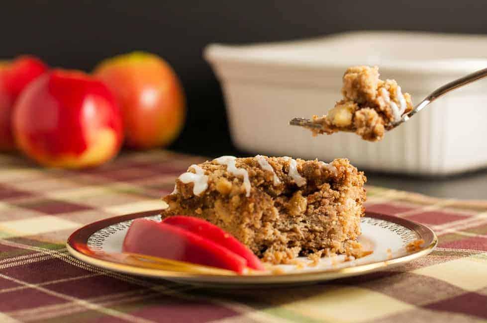 Taking a forkful of Gluten-Free Apple Cinnamon Coffee Cake