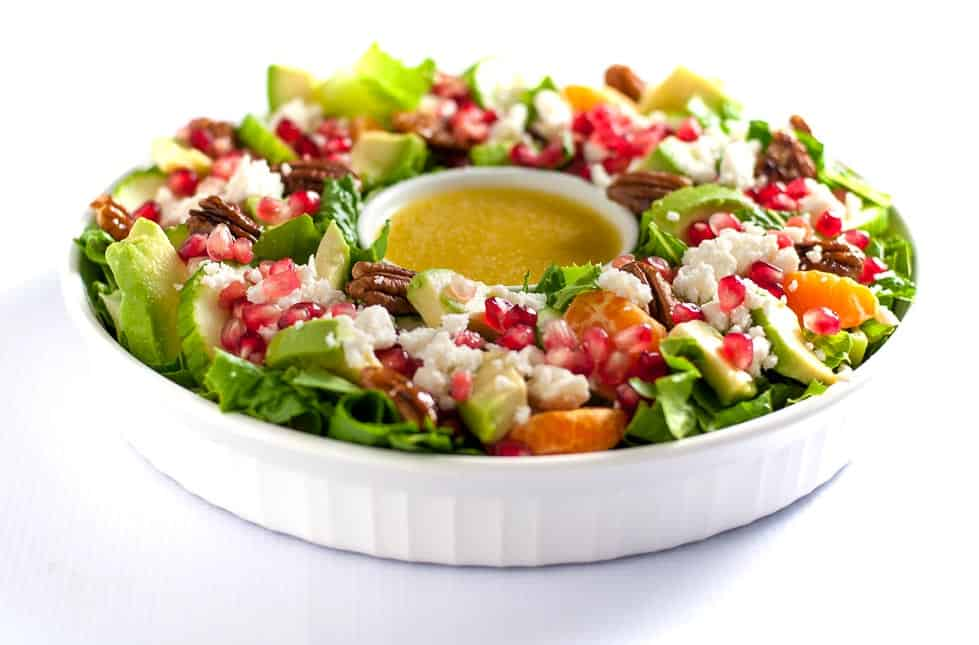 This Pomegranate Mandarin Salad with Avocado and Feta is a festive salad for any winter meal! It's bursting with fruit rich in Vitamin C, crunchy pecans and creamy avocado, and topped with crumbled feta or goat cheese. Serve it as a holiday wreath salad! One of 6 Tasty Healthy Winter Salads from Flavour and Savour