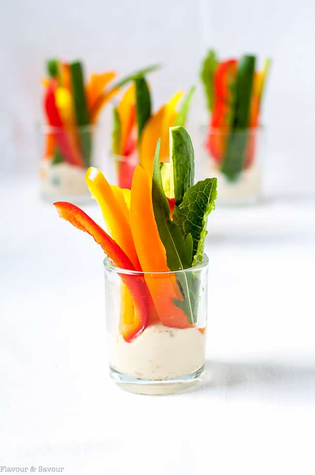 Creamy Cannellini Lemon Feta Dip with vegetables in individual glass cups. One of 15 Spring Brunch Recipe Ideas by Flavour and Savour