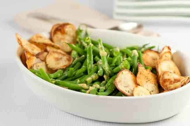 Here's a side dish that's an updated version of the old favourite green bean casserole! Tender green beans tossed with a Dijon-shallot vinaigrette and served with homemade crispy potato chips! |www.flavourandsavour.com