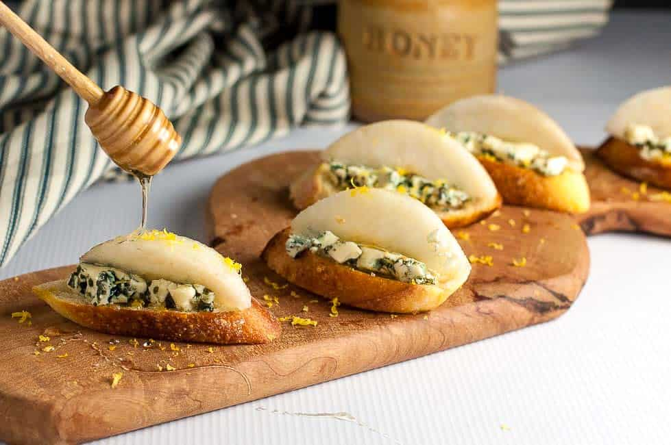 Blue Cheese Crostini with Crisp Honeyed Pear. Top thin slices of toasted baguette with blue cheese, a slice of crisp pear, a sprinkle of lemon zest and a drizzle of honey for a last-minute appetizer.  www.flavourandsavour.com