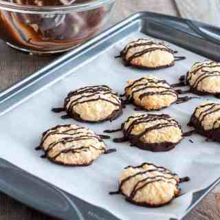 These gluten-free Chocolate Dipped Crispy Coconut Cookies are coated and drizzled with a thin layer of dark chocolate. Make ahead and freeze for unexpected company. |www.flavourandsavour.comT