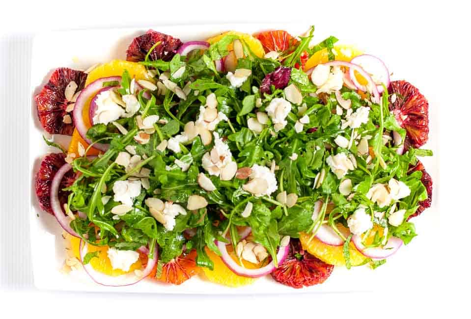 Winter Citrus Salad with Arugula and Goat Cheese. Sweet oranges, fresh mint and spicy arugula topped with tangy cheese and flaked almonds make a beautiful winter salad. One of 6 Tasty Healthy Winter Salads from Flavour and Savour.