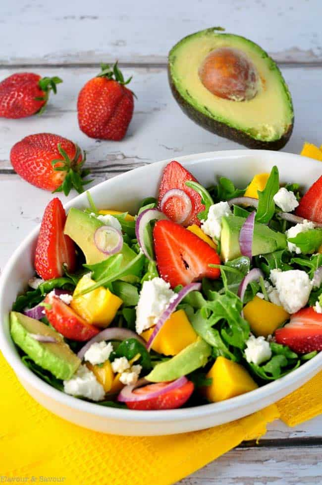 This Strawberry-Mango Arugula Salad with Goat Cheese combines fresh sweet strawberries, mango, spicy arugula, creamy avocado and goat cheese and is drizzled with a flavourful citrus vinaigrette. A beautiful spring salad.