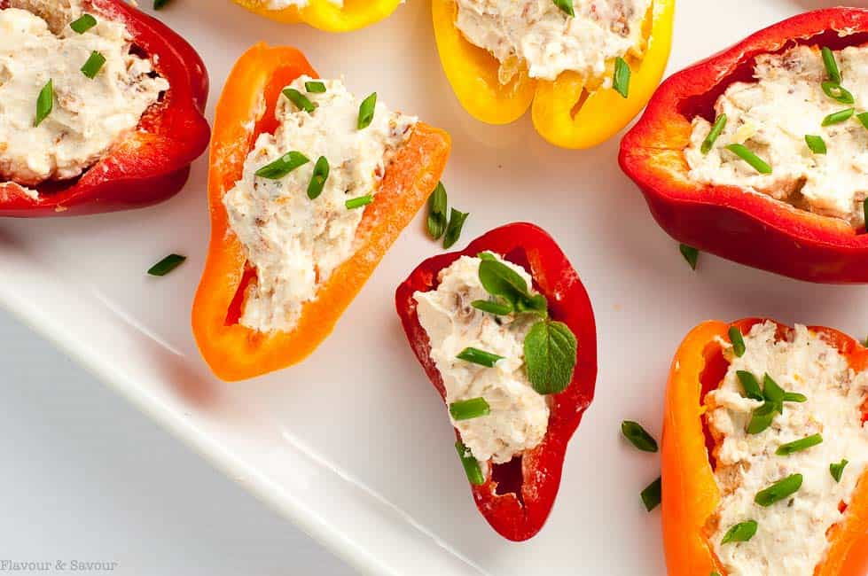 Get the recipe for this easy appetizer of Sun-dried Tomato, Artichoke and Cheese Stuffed Mini Peppers.