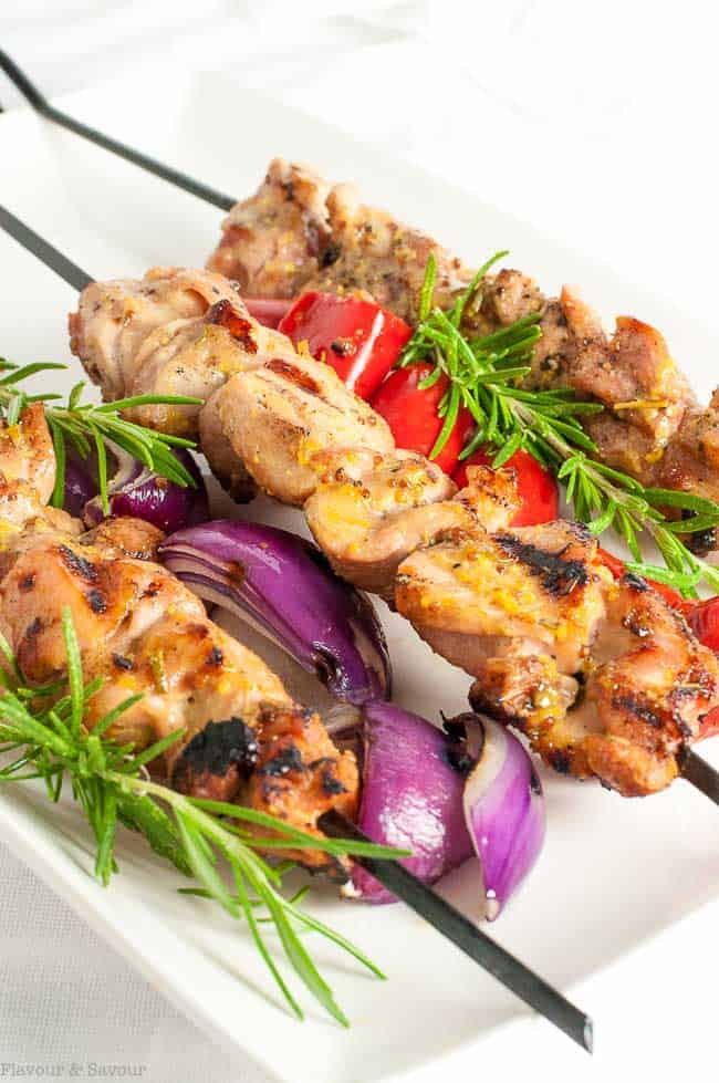 Grilled Rosemary Mustard Chicken Kabobs on a platter with skewered vegetables.