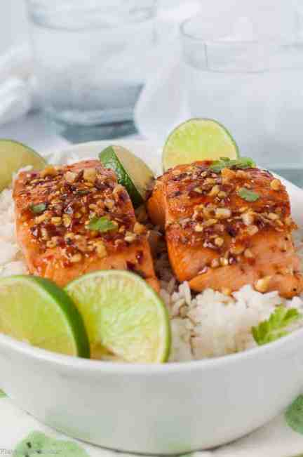 Honey Chili Lime Glazed Salmon served with rice and fresh lime slices. Serve with Pineapple Jicama Salad.