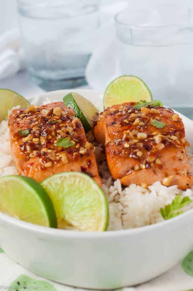 Honey Chili Lime Glazed Salmon served with rice and fresh lime slices