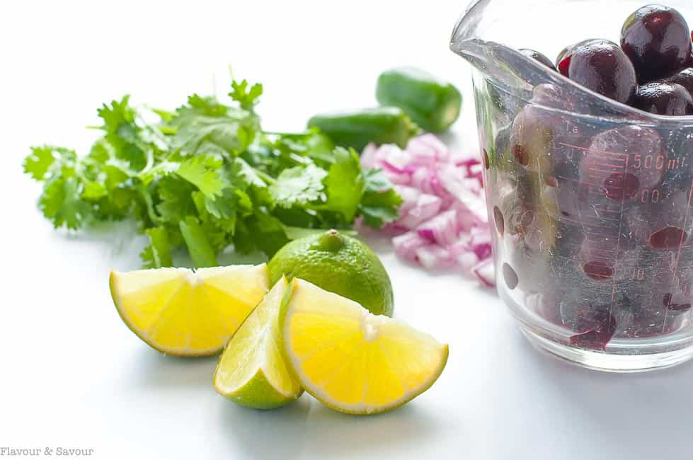 Fresh cherries, lime, jalapeno, red onion an cilantro for fresh cherry salsa