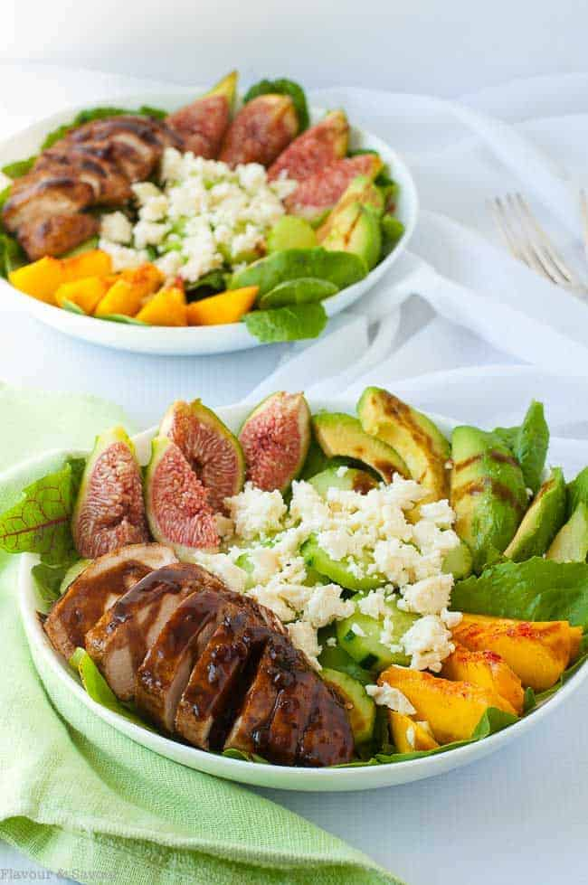 This Balsamic Glazed Chicken Salad combines succulent chicken breasts with garden greens, feta cheese, fresh figs, peaches and avocado. Summer in a bowl!