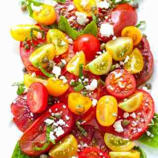 Basil, capers and feta cheese enhance the natural flavours of late-summer tomatoes in this simple recipe for Heirloom Tomato Salad. |www.flavourandsavour.com