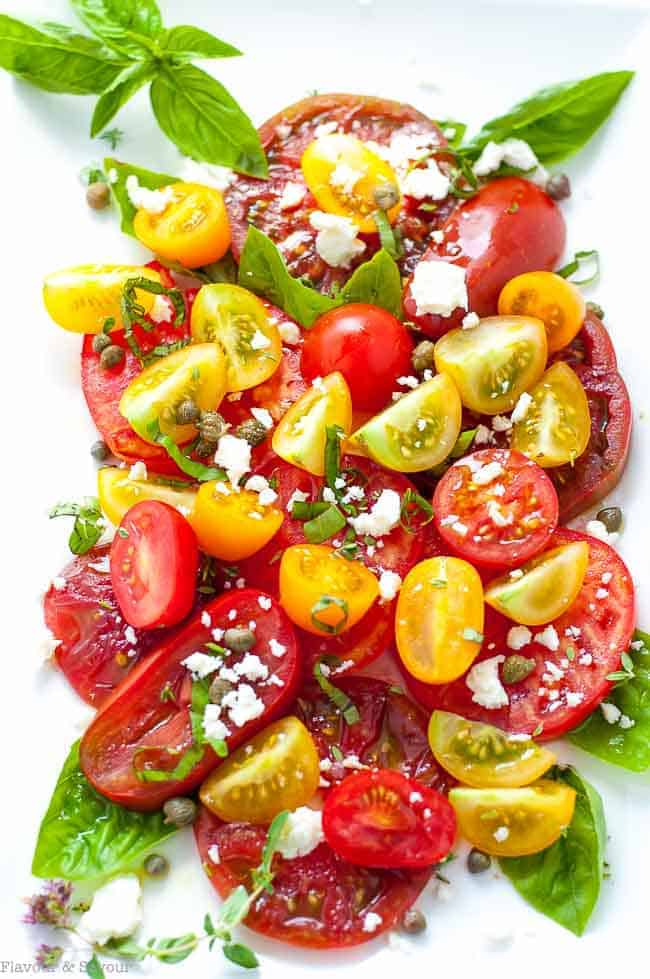 Heirloom Tomato Salad with Basil, Capers and Feta. Overhead view