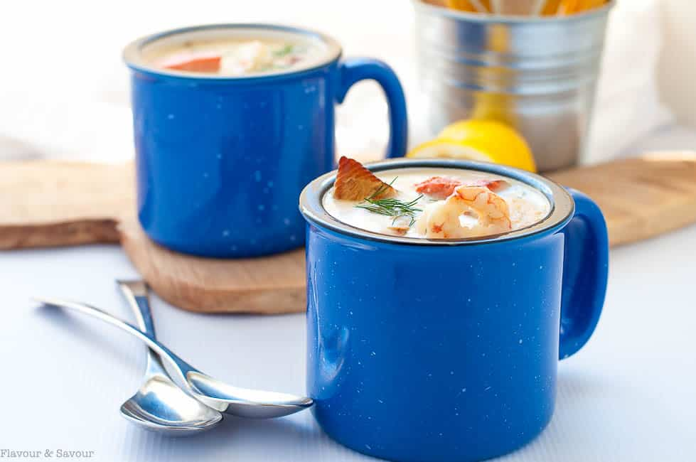 How to Make the Best Seafood Chowder. Two blue mugs of seafood chowder