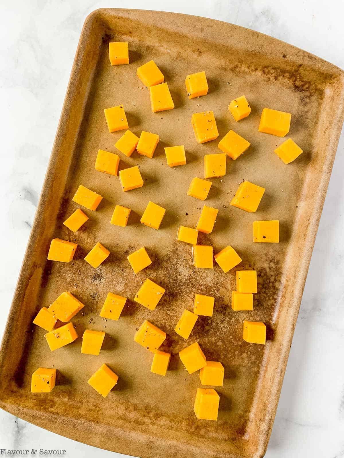 Butternut squash on a baking sheet
