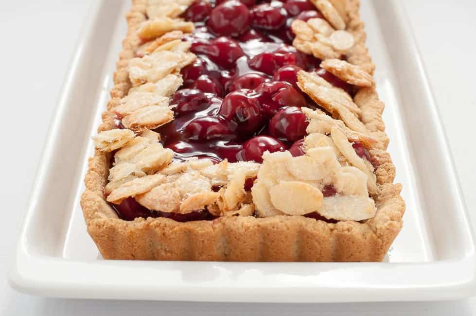 This Sour Cherry Almond Tart is gluten-free, it's just sweet enough, and it's an easy dessert to make for your next party! www.flavourandsavour.com