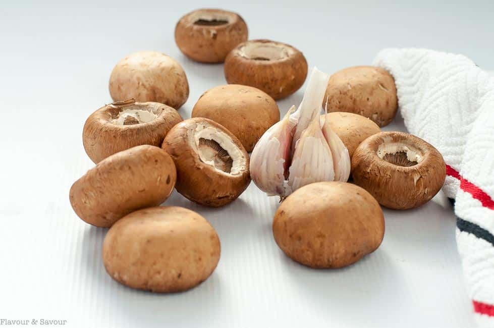 Preparing mushrooms for Garlic Lovers' Blue Cheese Stuffed Mushrooms