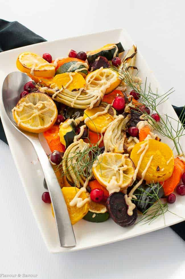 Lemon Tahini Roasted Vegetables. This one pan dish with a variety of oven roasted vegetables and lemon tahini dressing is a colourful, nutritious and flavourful side dish. Quick and easy. #Paleo and #vegan #tahini #roasted #harvest #vegetables